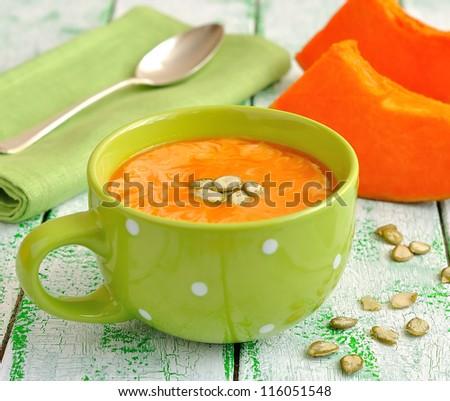 Pumpkin soup in a green bowl