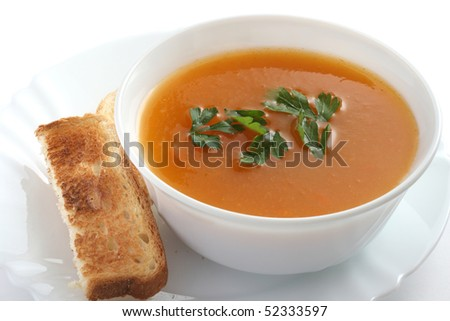 pumpkin soup in the white bowl with toast