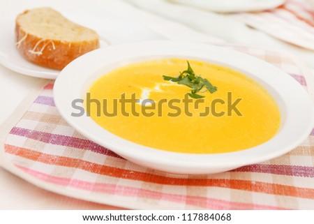 Pumpkin soup in white bowl - stock photo
