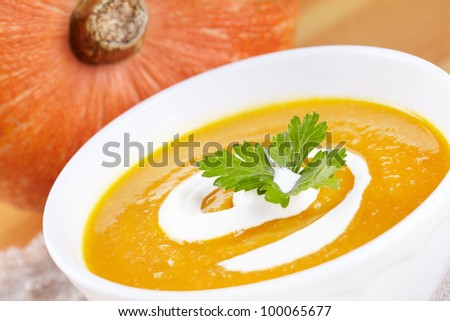 Pumpkin soup in white plate