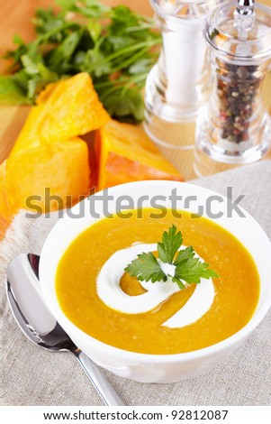 Pumpkin soup on the served table