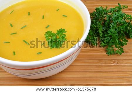 Pumpkin soup on wooden background. Polish cuisine.