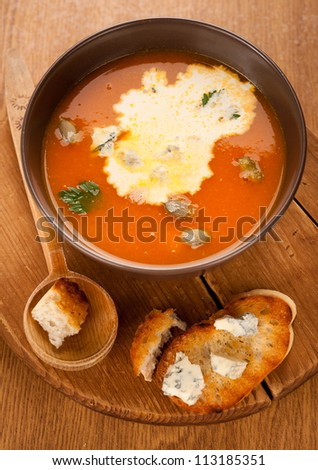 Pumpkin soup with cream, cheese and croutons