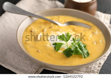Pumpkin soup with mushrooms decorated with parsley