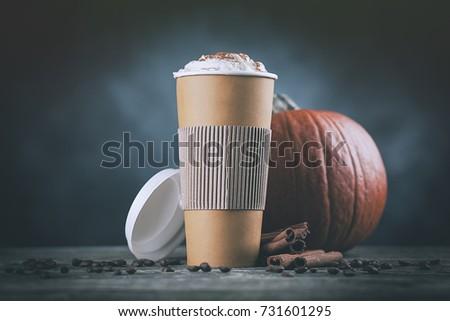 Pumpkin spice latte in a paper cup #731601295