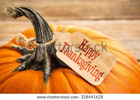 pumpkin with a Happy Thanksgiving paper price tag -  holiday shopping concept #328441628