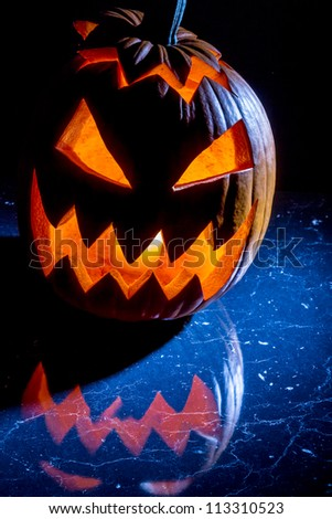 Pumpkin with candle lighted for halloween