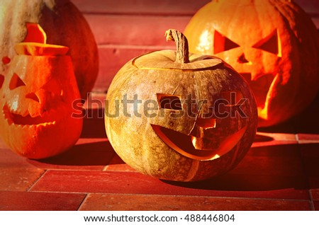 Pumpkin with grimaces in a red fluorescent lightning  (Halloween background for a party flyer) #488446804