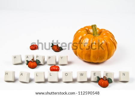 Pumpkins and happy halloween text with the upper part in white