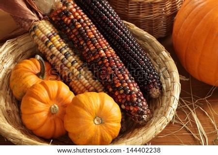 Pumpkins and indian corn arrangement.