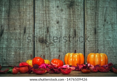 Pumpkins decorate with red dry leaf with wood background have space for copy , halloweeb concept.