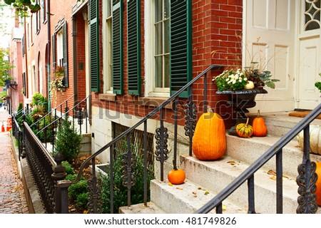 Pumpkins near the door during Halloween season