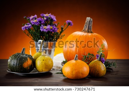 Pumpkins on planks #730247671
