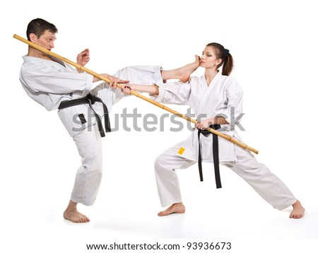 punch.figure in the karate fighting stance on a white background.hand-to-hand fighting.man and woman. - stock photo