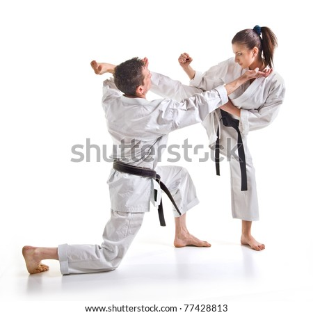 punch.figure in the karate.Training fight.two fighters on a white background hand-to-hand fighting.man and woman. - stock photo