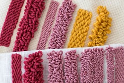 Punch Needle samples of different loops sizes. Different colour wool in various fabrics. DIY concept. Needlework.