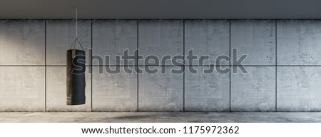 Punching bag hangs in front of a gray wall background in the fitness center (3d rendering)
