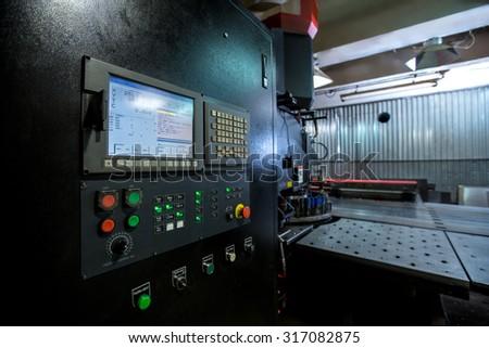 Punching machine. Foreground of control panel #317082875