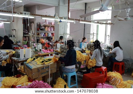 Puning,China-March 17:Unidentified Labors Work In Family Business Clothing Workshop In Canton On March 17 2013. China Manufacturing Trend To Move From Coastal To Inland Area Because The Cost Is Growth