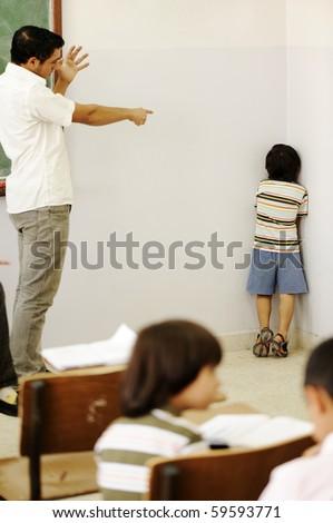 Punishing children in classroom, angry teacher and kid in corner