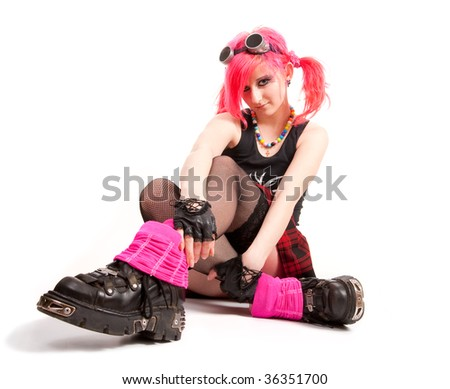 Punk girl portrait in studio isolated over white background