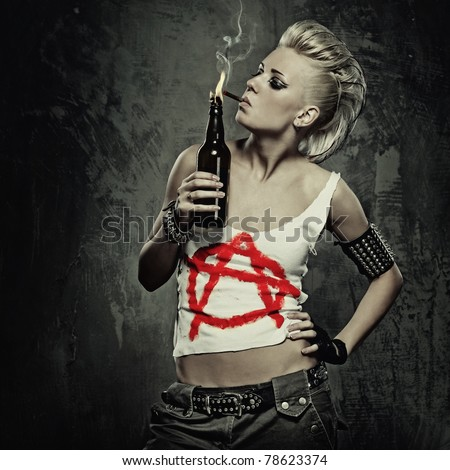 Punk girl smoking a cigarette - stock photo