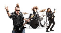 Punk rock band with female drummer and male and female guitarists isolated on white background