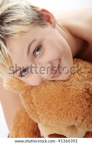Punk teen girl with teddy bear, isolated on white background