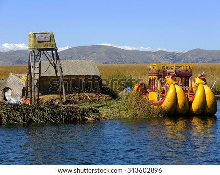 PUNO, PERU - JULY 17:  View of the traditional village of the floating Uros Islands on lake Tititaca, on July 17, 2015 in Puno, Peru. #343602896