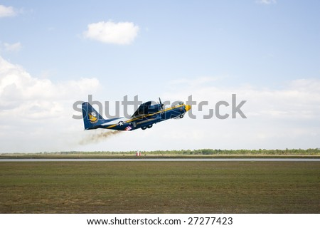 Punta Gorda, Fl.- March 21:The U.S. Navy's C-130 Hercules cargo support aircraft for the Blue Angels uses 8 rockets to assist a short take off at the Florida International Airshow on March 21-22, 2009