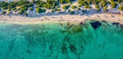 Punta Prosciutto is a wonderful stretch of Salento coast, part of the Municipality of Porto Cesareo, Puglia region, South Italy. long and unspoiled beach. Drone photo