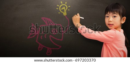 Pupil drawing with chalk against blackboard #697203370