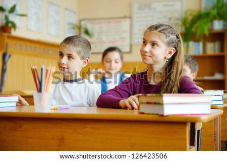 Pupils aged 11 sitting at the desks in classroom