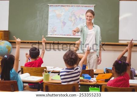 pupils raising hand in...