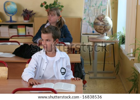 Pupils sitting at a school desk at a lesson