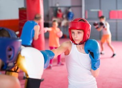 Pupils train in boxing sparring in training gym