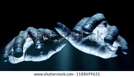Puppet hands from leadership controlling our lives. Concept #1188699631