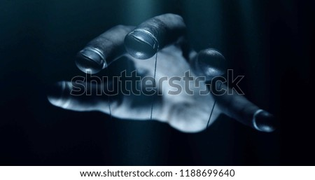 Puppet hands from leadership controlling our lives. Concept #1188699640