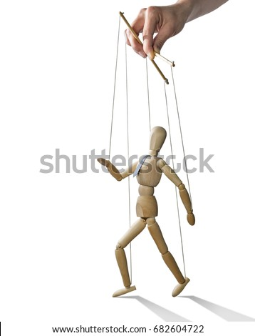 Puppet in the hands of puppeteer walks on isolated, white background.  Puppet is presented in business style with a tie. #682604722