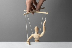 Puppeteer manipulates the doll. Voting unfair. The man raised his hand gives his fake voice