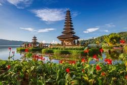 Pura Ulun Danu Bratan, Bali. Hindu temple surrounded by flowers on Bratan lake, Bali. Major Shivaite water temple in Bali, Indonesia. Water temple in Bali, Indonesia. Hindu temple of Bali, Indonesia