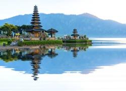 Pura Ulun Danu temple panorama reflection during sunrise on a lake Bratan, Bali, Indonesia