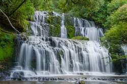 Purakaunui Falls, The Catlins, south island of New Zealand. Beautiful stairway waterfall.