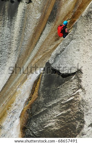 PURCARACCIA CANYON, CORSICA - AUGUST 28: An extreme sports team member participates  in a canyoning contest on the famous waterfalls of Purcaraccia valley, on August 28, 2010 in Corsica, France