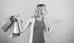Purchase concept. special offer on black friday. shop closeout. happy woman shopper. big sale. female shopaholic hold shopping bags. present packages for holiday preparation. summer discount.