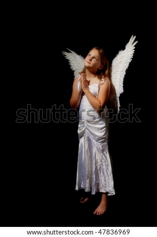 pure and innocent little angel fairy girl praying - stock photo