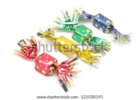 pure chocolate bonbons and milk chocolate wrapped in colored paper