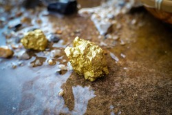 Pure gold ore found in mines with natural water sources.