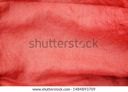 Pure linen cloth texture, macro. Living Coral colored pure linen texture. Living Coral Color 2019 year concept. Wrinkled linen fabric background. Natural linen texture