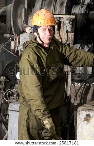 Pure russian drilling master at work - stock photo